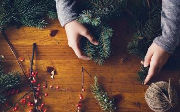 Teenage girl making a Christmas wreath