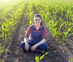 Farmer girl in corn field